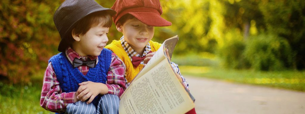 Children Reading Newspaper Outside, Nearsightedness, Optometrist, Milton, ON